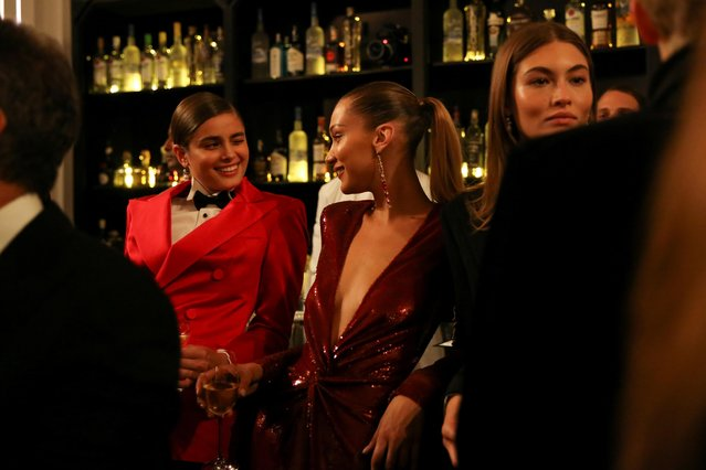 Bella Hadid and models enjoy beverages after presenting creations from the Ralph Lauren collection during New York Fashion Week in Manhattan, New York, U.S., September 7, 2019. (Photo by Caitlin Ochs/Reuters)