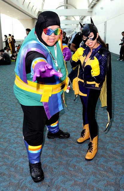 Costumed characters pose for photographs on day one of Comic-Con 2015 on Thursday, July 9, 2015 in San Diego, Calif. (Photo by Richard Shotwell/Invision/AP Photo)