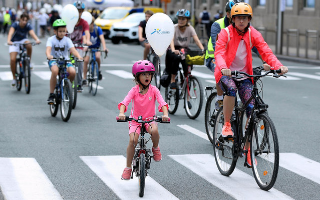 """People ride bikes in a street, in Brussels, Belgium during the """"Car Free Day"""", on September 22, 2019. The traffic is stopped for the day and the ban is applied to all motorized vehicles, except vehicles with special permit. (Photo by Dursun Aydemir/Anadolu Agency via Getty Images)"""