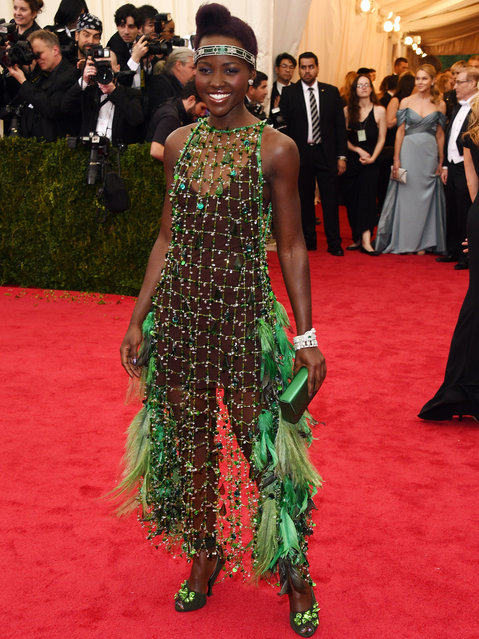 "Lupita Nyong'o attends the ""Charles James: Beyond Fashion"" Costume Institute Gala at the Metropolitan Museum of Art on May 5, 2014 in New York City. (Photo by Larry Busacca/Getty Images)"
