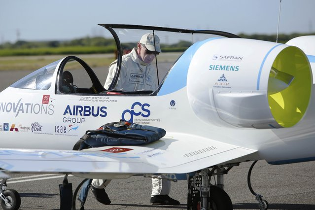 Pilot and designer Didier Esteyne inspects his aircraft before taking off in the Airbus Group E-Fan electric aircraft, during an attempt to fly across the channel from Lydd Airport in southeast England, Britain July 10, 2015. (Photo by Luke MacGregor/Reuters)