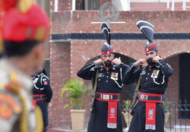 In this Friday, August 9, 2019, file photo, Pakistan Rangers soldiers face Indian Border Security Force soldiers at a daily closing ceremony on the Indian side of the Attari-Wagah border. India's recent clampdown has a long history in Kashmir and the conflict has existed since the late 1940s, when India and Pakistan won independence from the British empire and began fighting over rival claims to the Muslim-majority territory. India and Pakistan have fought two of their three subsequent wars over Kashmir, and each administers a portion of the region. India has long seen the Kashmiri struggle for self-determination as Islamabad's proxy war against New Delhi. (Photo by Prabhjot Gill/AP Photo/File)