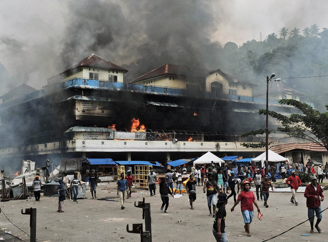 Local market is seen burning during a protest in Fakfak, Papua province, Wednesday, August 21, 2019. Indonesia has deployed over 1,000 security personnel to the restive province of West Papua amid spreading violent protests sparked by accusations that security forces had arrested and insulted Papuan students in East Java. (Photo by AP Photo/Beawiharta)