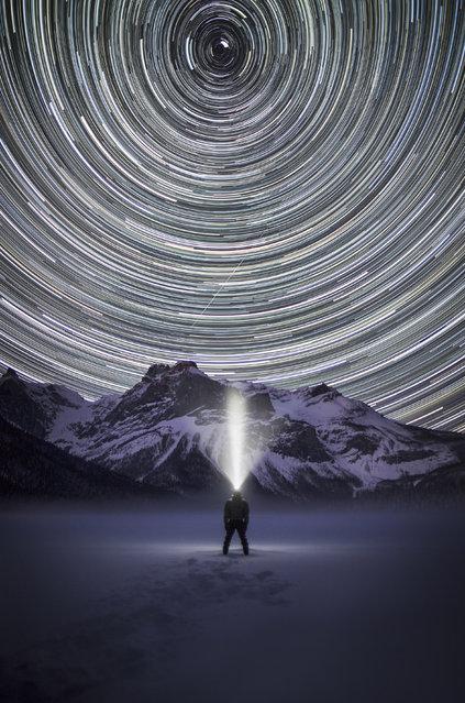 "Paul Zizka in ""Steward Of The Stars"", Emerald Lake, Yoho National Park, BC, Canada, December 6, 2013. (Photo by Paul Zizka/Caters News)"