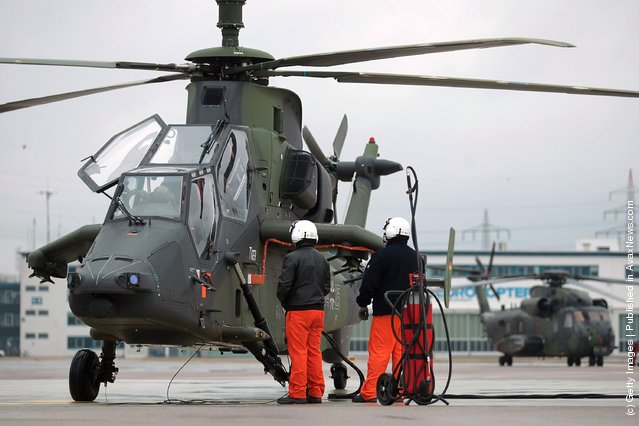 Workers check an Eurocopter Tiger military attack helicopter at the Eurocopter plant