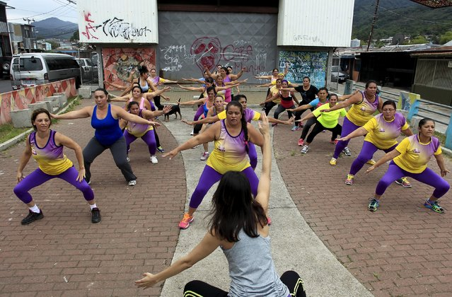 Andrea Abarca, (C) leads an aerobics class in Los Guidos de Desamparados July 23, 2015. (Photo by Juan Carlos Ulate/Reuters)