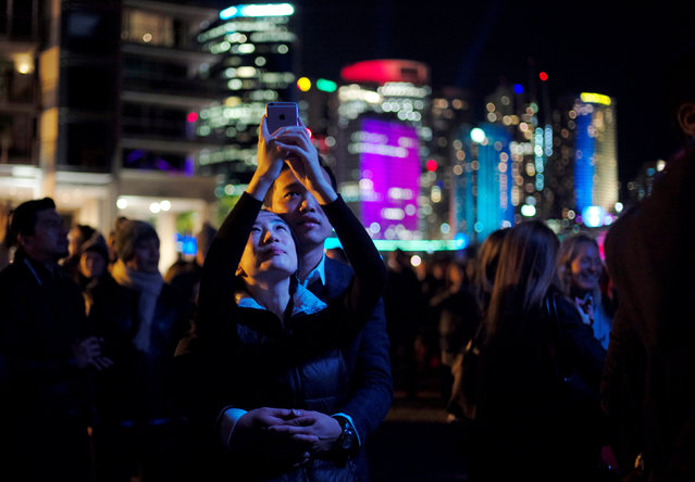 A couple embrace as they experience the opening night of the annual Vivid Sydney light festival in Sydney, Australia May 27, 2016. (Photo by Jason Reed/Reuters)