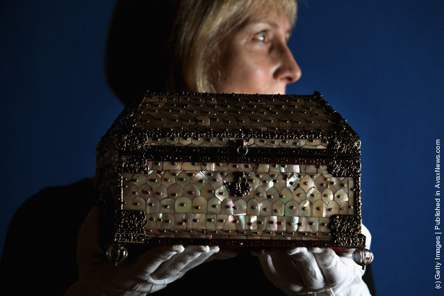 Curator Deborah Clarke, holds a casket presented to Queen Elizabeth the Queen Mother in 1938, part of the Royal Collection