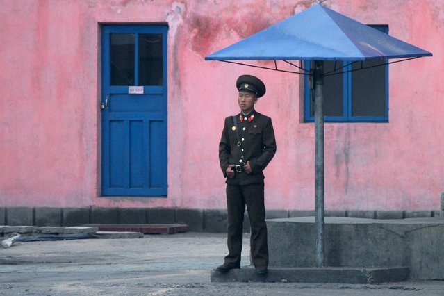 A North Korean soldier stands guard on the banks of the Yalu River, near the North Korean town of Sinuiju, opposite the Chinese border city of Dandong, May 2, 2015. (Photo by Jacky Chen/Reuters)
