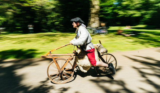 Participants dressed in historical clothing ride high-wheel and other historical bicycles during a bicycle ballet event at Schloss Karlsruhe palace during the 2017 International Veteran Cycle Association (IVCA) rally to celebrate the 200th anniversary of the bicycle on May 27, 2017 in Karlsruhe, Germany. (Photo by Alexander Scheuber/Getty Images)