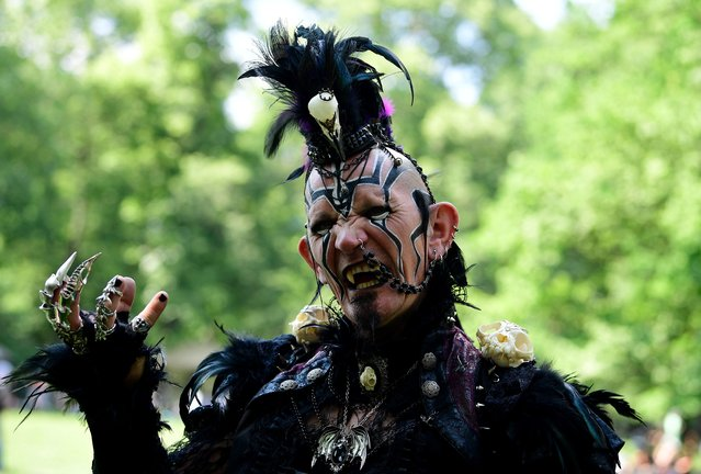 "A dressed up man attends a so-called ""Victorian Picnic"" during the Wave-Gotik-Treffen (WGT) festival in Leipzig, eastern Germany, on June 2, 2017. (Photo by Tobias Schwarz/AFP Photo)"