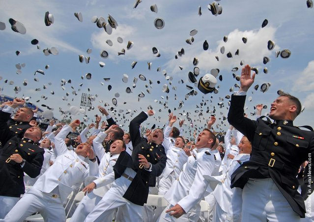 Newly commissioned Navy and Marine Corps officers toss their hats after the U.S. Naval Academy Class of 2011 graduation and commissioning ceremony. The Class of 2011 graduated 728 ensigns and 260 Marine Corps 2nd lieutenants at Navy-Marine Corps Memorial Stadium in Annapolis