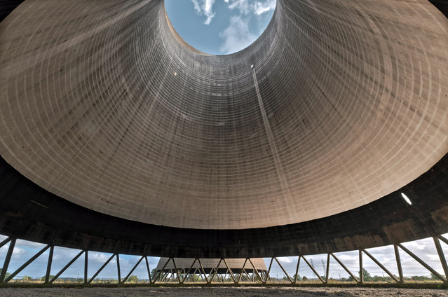 Vertigo inducing: Clouds float above the cooling tower. (Photo by Mike Deere/Caters News)
