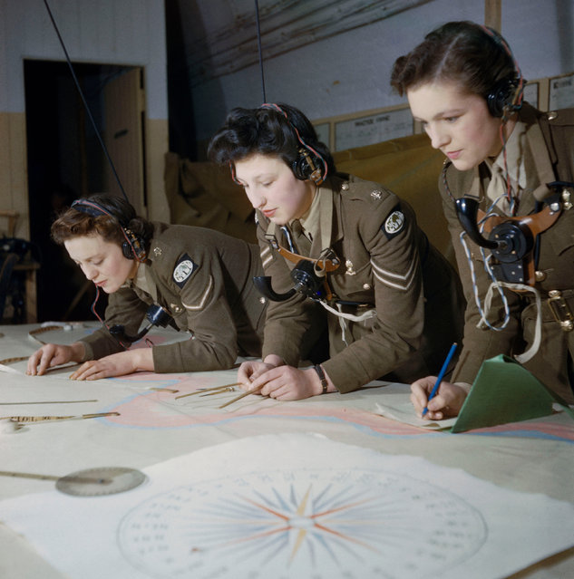 Auxiliary Territorial Service (ATS) plotters at work at Coastal Artillery Headquarters in Dover, December 1942. (Photo by Ted Dearberg/IWM/PA Wire)