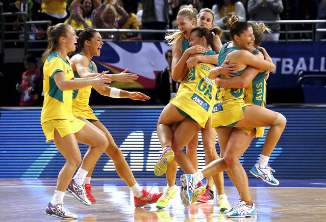Members of the Australian team celebrate after winning their Netball World Cup final game against New Zealand in Sydney, Australia, August 16, 2015. (Photo by David Gray/Reuters)