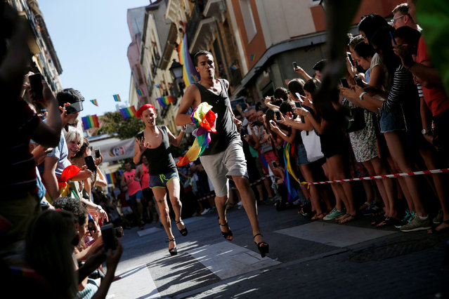 Competitors take part in the annual race on high heels during Gay Pride celebrations in the quarter of Chueca in Madrid, Spain, June 30, 2016. (Photo by Susana Vera/Reuters)