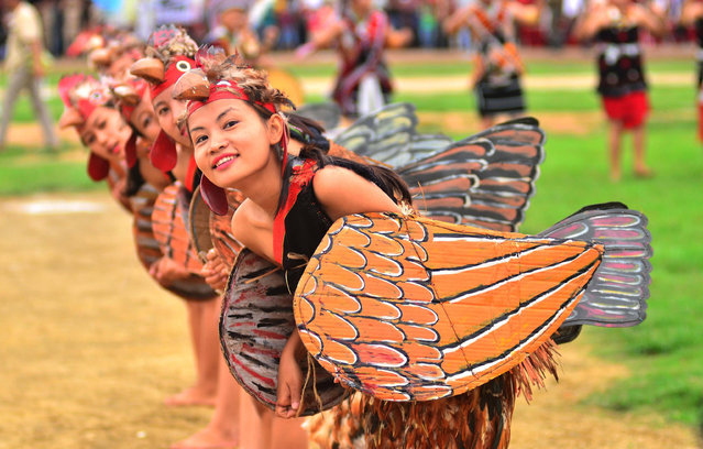 Chakeshang Naga performs a chicken dance to mark the country's 70th independence day celebrations in Dimapur, India on Tuesday, August 15, 2017. (Photo by Caisii Mao/Alamy Live News)