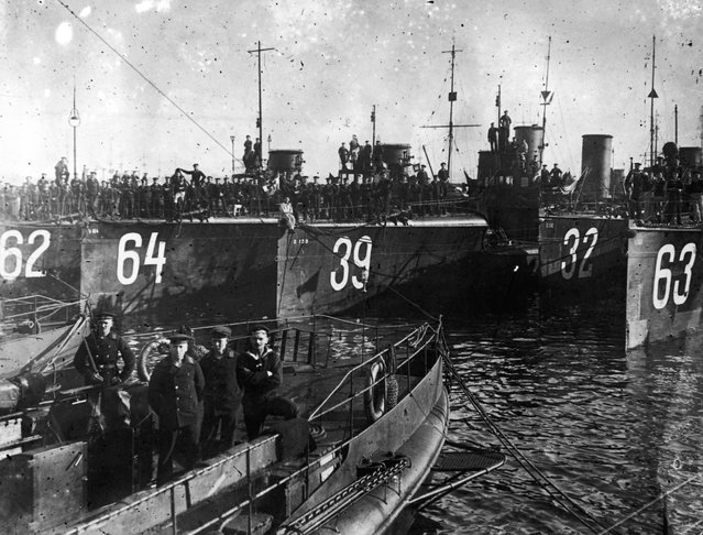 Men and ships of the German Torpedo Flotilla in the Kiel Canal in Germany, 1914.