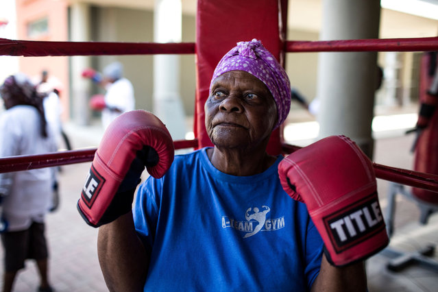 "79 year old Constance Ngubane prepares to take part in a ""Boxing Gogos"" (Grannies) training session hosted by the A Team Gym in Cosmo City in Johannesburg on September 19, 2017. (Photo by Gulshan Khan/AFP Photo)"