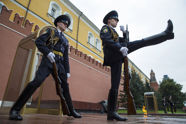 The Kremlin guards change at the Tomb of Unknown Soldier outside the Kremlin wall in downtown Moscow, Russia, Wednesday, September 2, 2015. (Photo by Pavel Golovkin/AP Photo)