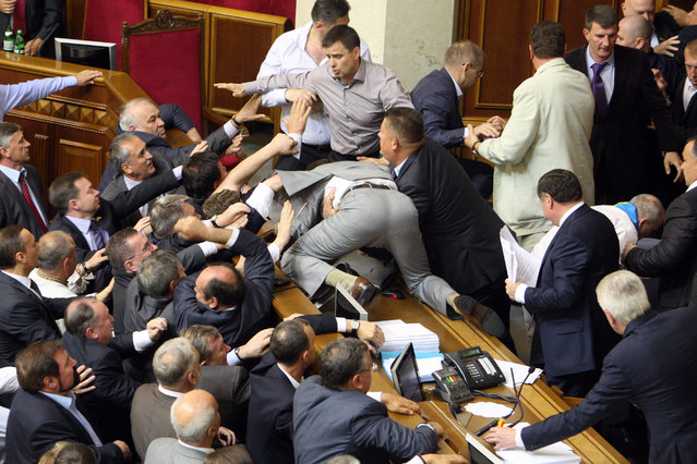 Deputies of the Ukrainian opposition fight with deputies of the pro-presidential majority during a session of parliament in Kiev, as opposition parties protest a bill proposed by the ruling party which would make Russian an official state language along with Ukrainian on May 24, 2012. (Photo by AFP Photo/Stringer)