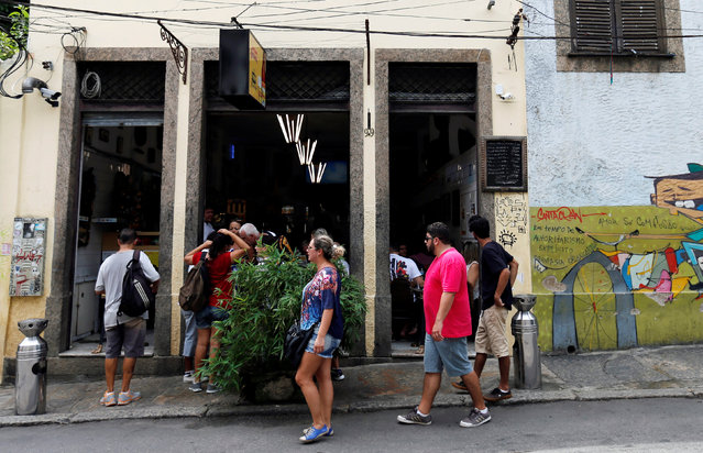 People arrive to eat the Brazilian traditional dish feijoada (black bean and meat stew) at the Bar do Mineiro in Rio de Janeiro, Brazil, March 24, 2016. (Photo by Sergio Moraes/Reuters)