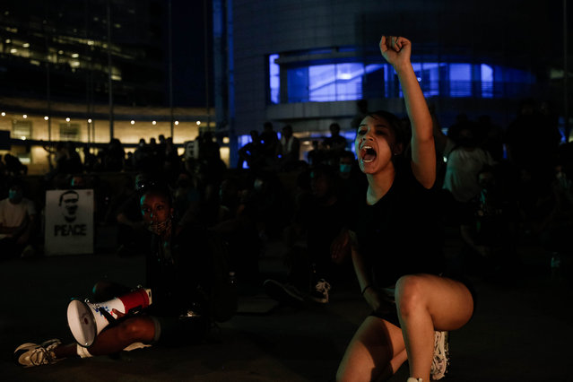 Jasmine Williams, right, leads a chant during a demonstration over the police killing of George Floyd in downtown San Jose, Calif., on Wednesday, June 3, 2020. (Photo by Randy Vazquez/Bay Area News Group)