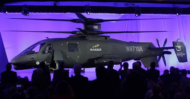 The new Sikorsky Aircraft S-97 RAIDER helicopter, is seen during its unveiling ceremony at Sikorsky Aircraft in Jupiter, Florida October 2, 2014. The S-97 is a technologically advanced, armed scout helicopter, designed to outmatch conventional military helicopters in speed, maneuverability, payload, and high altitude operations, according to a Sikorsky news release. (Photo by Andrew Innerarity/Reuters)