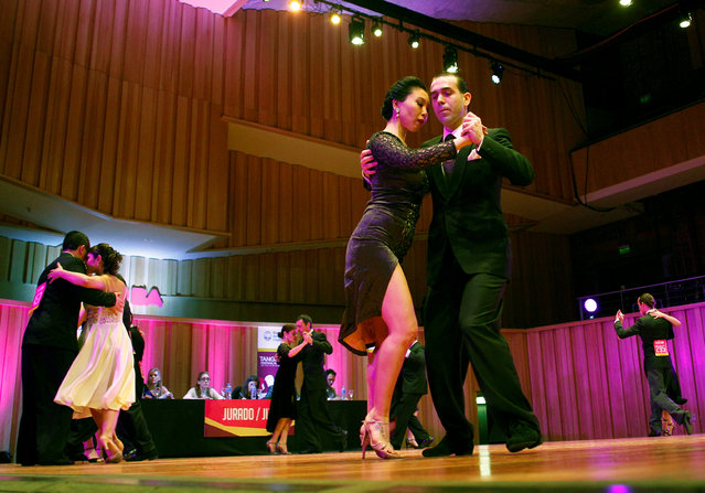 Couples compete in the Salon Tango style qualifier round at the 13th edition of the Tango World Championship in Buenos Aires, Argentina, August 22, 2016. (Photo by Enrique Marcarian/Reuters)