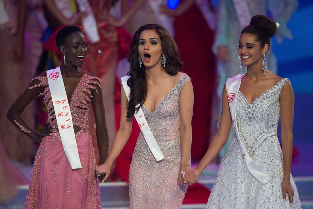 Miss India Manushi Chhilar (C) reacts as she wins the 67 th Miss World contest final next to France Aurore Andrée Raphaëlle Kichenin (R) and Miss Kenya Magline Jeruto (L) in Sanya, on the tropical Chinese island of Hainan on November 18, 2017. (Photo by Nicolas Asfouri/AFP Photo)
