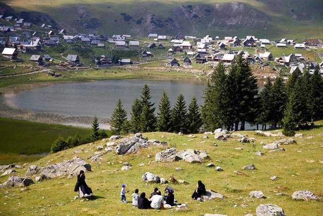 Tourists from the Middle East enjoy along the Prokosko Lake near Fojnica, Bosnia and Herzegovina, August 20, 2016. (Photo by Dado Ruvic/Reuters)