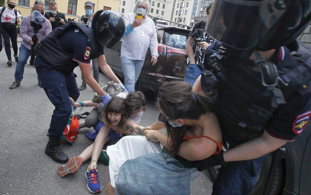 Police detain people protesting against the court verdict for Yuliy Boyarshinov, and Viktor Filinkov, members of a left-wing group Set (Network) at the Western regional military court in St.Petersburg, Russia, Monday, June 22, 2020. A Russian military court convicted two members of a left-wing youth group of terrorism Monday and sentenced them to prison terms of five and a half and seven years, in a case that human rights groups called fabricated and based on coerced testimony. (Photo by Dmitri Lovetsky/AP Photo)