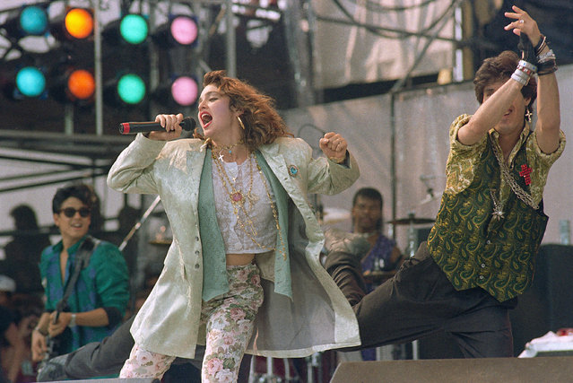 American singer Madonna, performs onstage with dancer during Live Aid famine relief concert at JFK Stadium in Philadelphia Pa., July 13,1985. (Photo by Amy Sancetta/AP Photo)