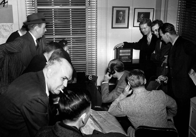 White House reporters listen to the radio in the White House press room as Japan declares war on the U.S., December 7, 1941. (Photo by Associated Press)