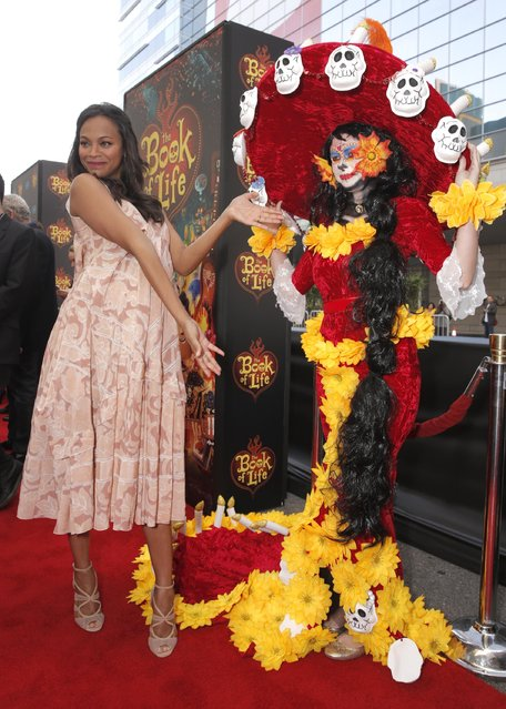 "Zoe Saldana attends the Twentieth Century Fox and Reel FX Animation Studios premiere of ""The Book of Life"" on Sunday, October 12, 2014, in Los Angeles. (Photo by Todd Williamson/AP Photo)"