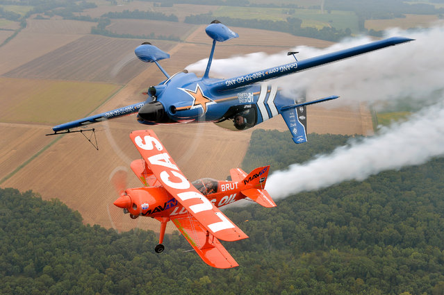 John Klatt and the Air National Guard MXS (top) and Mike Wiskus and the Lucas Oil Pitts take to the skies at the Memphis Airshow, on Sat., September 26, 2016 in Millington, Tenn. (Photo by Brandon Dill/Invision for John Klatt Airshows, Inc./AP Images)