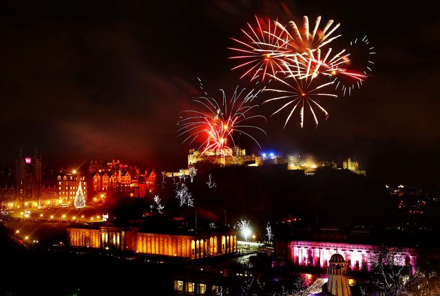 Fireworks go off over Edinburgh Castle in Scotland as part of New Year Hogmanay celebrations. (Photo by Danny Lawson/Press Association)