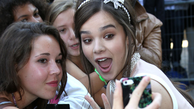 Hailee Steinfeld poses for a selfie after the Miu Miu fashion show as part of the Paris Fashion Week Womenswear Spring/Summer 2015 on October 1, 2014 in Paris, France. (Photo by Jean Catuffe/GC Images)