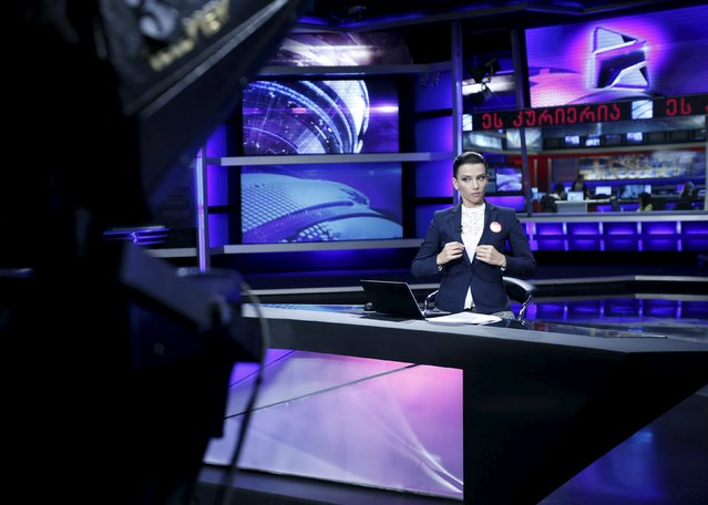 Television host Nelli Agirba gets ready for a live broadcast at Rustavi 2 TV station in Tbilisi, Georgia, October 2, 2015. Georgia's biggest independent TV company, Rustavi 2, said a court ordered the seizure of a major owner's shares on Thursday in what the broadcaster called an attempt to silence its criticism of the government. (Photo by David Mdzinarishvili/Reuters)