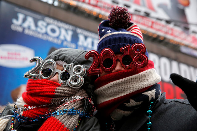 Revelers gather in Times Square as a cold weather front hits the region ahead of New Year's celebrations in Manhattan, New York, December 31, 2017. (Photo by Andrew Kelly/Reuters)