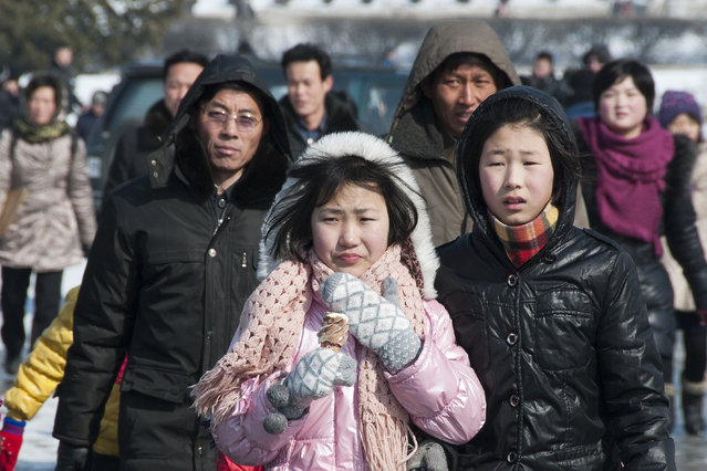 Residents of the capital dressed in coats and gloves in February 2013, in Pyongyang, North Korea. (Photo by Andrew Macleod/Barcroft Media)