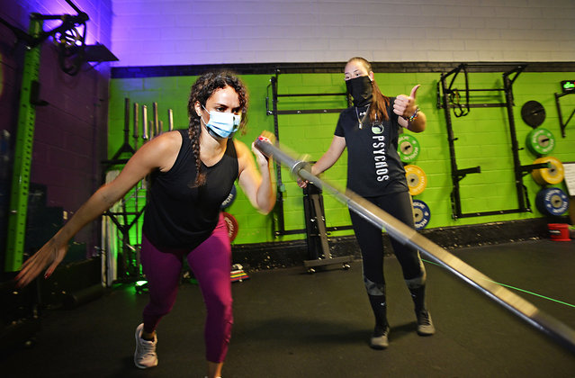 Natasha Lopez, 31, works out with trainer Jasmine Penuela, 23, at Sage Fitness Studios in Astoria after the coronavirus lockdown, on September 2, 2020. (Photo by Matthew McDermott/The New York Post)