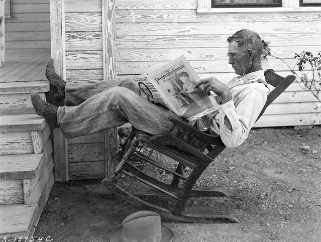 """Farmer reading his farm paper"". Coryell County, Texas, September 1931. (Photo by George W. Ackerman)"