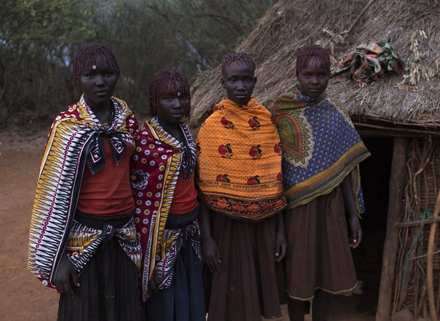 Pokot girls stand outside one of the girl's homes prior to the beginning of their circumcision ceremony in a village about 80 kilometres from the town of Marigat in Baringo County, October 16, 2014. (Photo by Siegfried Modola/Reuters)