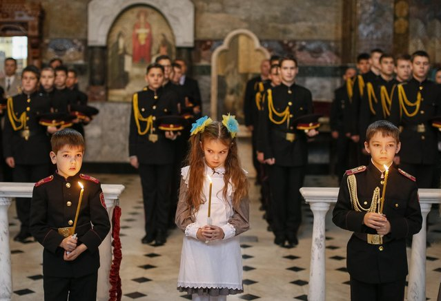 Young military cadets take part in an oath-taking ceremony at the Kiev Pechersk Lavra monastery in Kiev, November 14, 2014. (Photo by Gleb Garanich/Reuters)