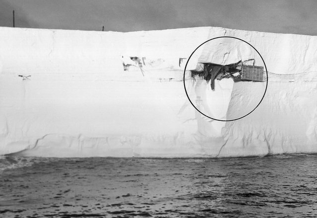 "Admiral Richard Byrd's ""Little America III"" station, built in Antarctic in 1940, was spotted by a Navy icebreaker sticking out of the side of this floating iceberg in the Antarctic's Ross Sea, on March 13, 1963. The old outpost was buried beneath 25 feet of snow, 300 miles away from its original location. A helicopter pilot flew in close and reported cans and supplies still stacked neatly on shelves. (Photo by AP Photo/Official U.S. Navy Photo)"