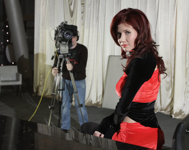 Deported Russian spy Anna Chapman appears in the studio as she hosts 'Mysteries of the World With Anna Chapman' television show on Ren-TV private federal TV channel in Moscow, Russia on January 13, 2011. (Photo ITAR-TASS/REN TV channel's press service)