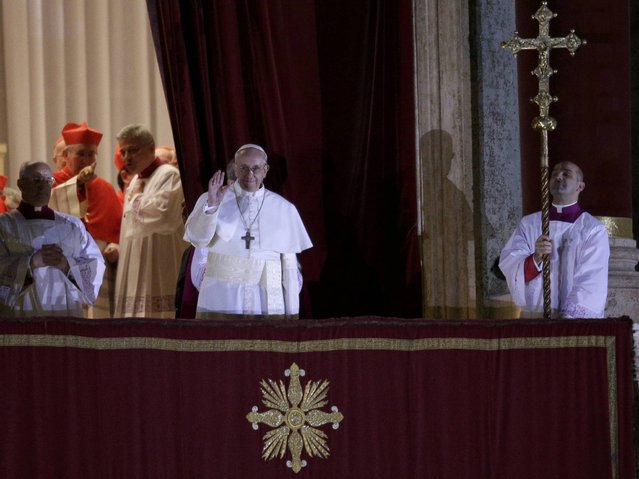 Newly elected Pope Francis, Cardinal Jorge Mario Bergoglio of Argentina appears on the balcony of St. Peter's Basilica after being elected by the conclave of cardinals, at the Vatican, March 13, 2013. White smoke rose from the Sistine Chapel chimney and the bells of St. Peter's Basilica rang out on Wednesday, signaling that Roman Catholic cardinals had elected a pope to succeed Benedict XVI. (Photo by Max Rossi/Reuters)