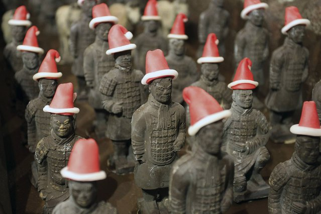 Miniature chocolate Terracotta Warriors wearing Santa Claus hats are displayed at the lobby of a hotel for the upcoming Christmas celebrations in Xi'an, Shaanxi province November 21, 2014. (Photo by Reuters/China Daily)
