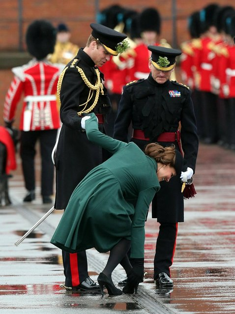 The Duchess of Cambridge gets her heel stuck in a drain as the Duke and Duchess of Cambridge visit the 1st Battalion Irish Guards to attend the St. Patrick's Day Parade at Mons Barracks, Aldershot, on March 17, 2013. (Photo by Steve Parsons/PA Wire)